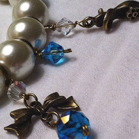 Glass pearl stretch bracelet with bows and princess shoes and crystals