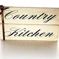 """Country Kitchen Wall Home Decor - Distressed/Rustic White Wood Wall Hanging Decor with the words """"Country Kitchen"""" on the front."""