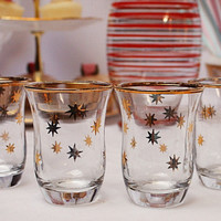 Set of 4 gold star/ asteroid.  party glasses with gilded stars : perfect set of fruit juice glasses for a retro party