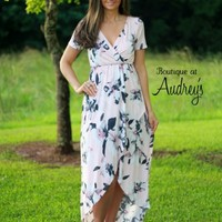 Light Pink Floral Wrap Dress with High Low Hem - Boutique At Audrey's