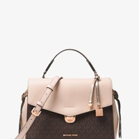 Michael Kors: Designer handbags, clothing, watches, shoes, and more.