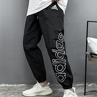 Adidas New fashion letter print couple pants Black