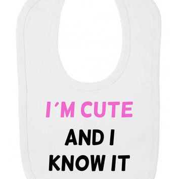 I'm Cute And I Know It (Pink Text) Funny Cheeky Velcro Fastening Baby Bib