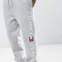 Tommy Jeans Sweat Pants Regular Fit Logo in Gray at asos.com