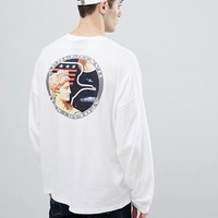 ASOS DESIGN NASA oversized long sleeve t-shirt with brack print at asos.com