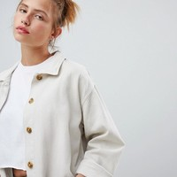Pull&bear ecru wash denim jacket longline at asos.com