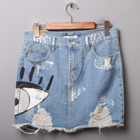 2017 Summer Hot Clothes Women Chic Skirts Pocket Hole Mini Denim Skirt Hand Painted Eye Style Vintage Ladies Casual Denim Skirt