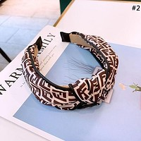 Dior new women's wide-brimmed letters knotted headband hairpin