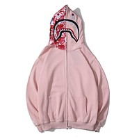 BAPE selling a new line of embroidered shark camouflage cap zip-up jackets Pink3