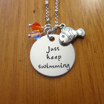 """Disney's """"Finding Nemo"""" Inspired Necklace. Dory """"Just Keep Swimming"""". Silver colored, Swarovski crystals, for women or girls"""
