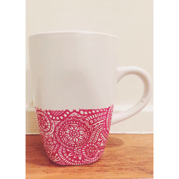 mug decorated with oil sharpie - red mandala design on it