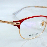 Vintage GUCCI Eyeglasses  Red and Gold Gold Frame Bamboo Logo Oval Shape Demonstration Lens in original package, Great Gift, Mint.