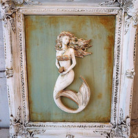 White framed mermaid sculpture wall hanging beach cottage distressed deep vintage frame sea green blue background decor anita spero design
