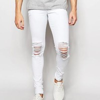 ASOS | ASOS Extreme Super Skinny Jeans With Extreme Knee Rips at ASOS
