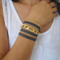 Black leather wrap bracelet with gold plated chunky chains