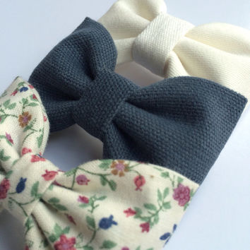 Winter white, textured blue, and vintage floral hair bow set from Seaside Sparrow. These hair bows make a perfect gift for her.