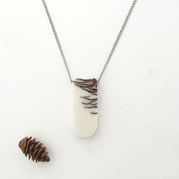 Bioresin and pinecone long rounded pendant