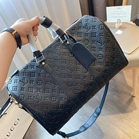 Hipgirls Louis Vuitton LV new vintage embossed letters men and women large capacity duffel bag