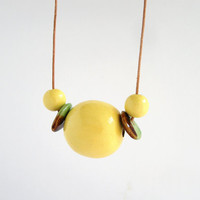 Wooden necklace, yellow necklace, wooden bead necklace, large bead necklace, geometric necklace, leather cord necklace, boho necklace, ooak
