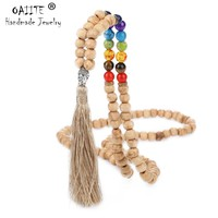 OAIITE Bohemian Ethnic Natural Wooden Beads 7 Chakra Necklace for Women Long Tassel Buddha Head Meditation Prayer Yoga Necklace