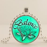 "Balance. Lotus flower, green,  1"" glass and metal Pendant necklace Jewelry."
