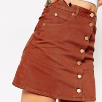 ASOS TALL Denim Dolly A-line Button Through Mini Skirt in Rust at asos.com