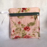 "Vinyl see through padded zippered case is versatile and is 7 1/2"" x 7 3/4"". Light pink backgrond with beautiful roses cotton fabric"