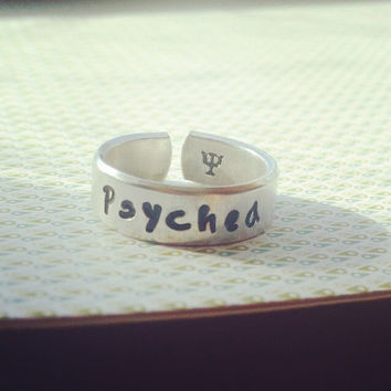 psyched PSI symbol inside   aluminum cuff style ring 1/4 inch