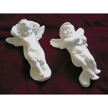 A Giannelli Italy Chalk Ware Signed Putti Paperweights