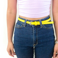 80s 90s yellow pleather belt, bright vintage leather, 1990s girls kawaii, urban outfitters tumblr fashion, vaporwave aesthetic soft grunge