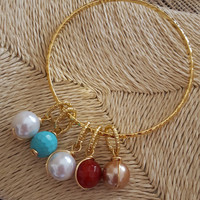 Single thin gold plated bracelet with 5 bead charms.