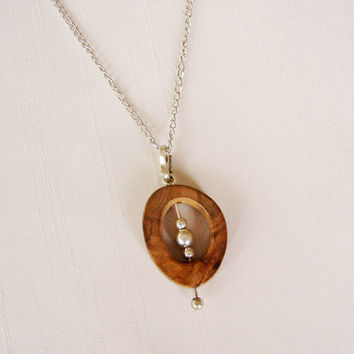 Sterling Silver and Llao-llao Wood Pendant - Oval Pendant with moving ball in the center - Simple Delicate Original Contemporary Necklace