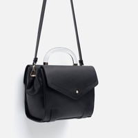 Bag with handle and strap