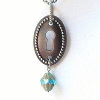 Gunmetal Keyhole Necklace with a Teal Cathedral Czech Glass Dangle, Steampunk Escutcheon, Industrial Style