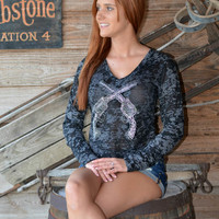 show off your cowgirl side in this fashionable burnout long sleeve crystal bling crossed pistol gun shirt