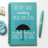 Writing journal, spiral notebook, bullet journal, blue, sketchbook, blank lined grid - Life isn't about waiting for the storm to pass