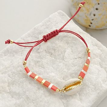 Friendship Bracelet with Cowrie shell in pink