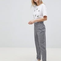 ASOS DESIGN tailored gingham tapered PANTS with belt and buckle detail at asos.com