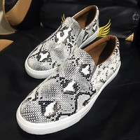 Stylish round-toed pair of plus-size flat low tops with snake print