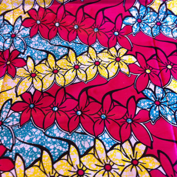 African Wax Print Fabric by the HALF YARD.  Flowers in yellow, turquoise and hot pink.