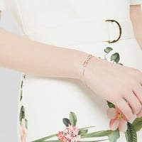 Bow detail crystal cuff - Rose Gold   Jewellery   Ted Baker ROW