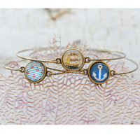 Adorable Bangle Sets are a unique way to accessorize! Each set is comprised of three different images, all of which relate to each other beautifully. The Bangles are attached with a jump ring, and are made of Nickel Free Lead Free antique bronze plated Bra