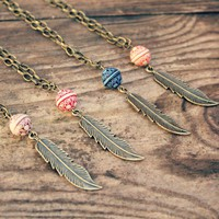 brass feather necklaces