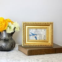 Original art collage made with vintage sheet music in gold frame.  Home decor for apartments, dorm, small spaces.  Blue song bird