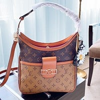 LV with small daisy pendant. Louis Vuitton shopping bag neverfull BAG metal Belt buckle bag