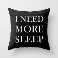 I NEED MORE SLEEP black Throw Pillow by Sara Eshak