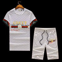 GUCCI tide brand men's classic letter signature printing short-sleeved sports suit two-piece white