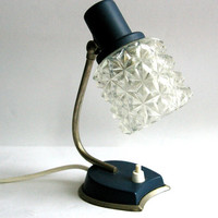 Vintage mid-century bedside lamp with glass shade.