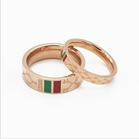 Gucci:Red green bar ring rose gold titanium steel waterproof ring men and women couple on the ring ring
