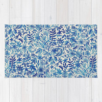 Floating Garden - a watercolor pattern in blue Rug by Micklyn